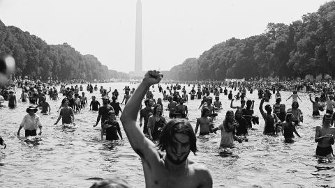"""Protesters wade in the Reflecting Pool at the National Mall in Washington during the """"Honor America Day Smoke-In"""" thrown by marijuana activists in response to the official """"Honor America Day"""" rally organized by President Nixon supporters at the Lincoln Memorial on July 4, 1970."""