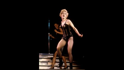 """Ever a fan of the bustier, Madonna struts her stuff during the 1987 """"Who's That Girl"""" tour."""