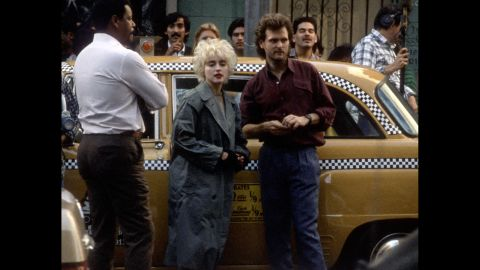 """Madonna and director James Foley work on the set of """"Who's That Girl"""" on November 24, 1987, in Los Angeles."""