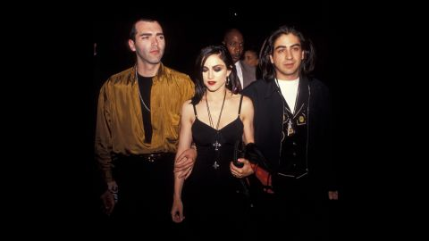 """Younger brother Christopher Ciccone, left, Madonna and director Alek Keshishian attend the """"Truth or Dare"""" premiere in Los Angeles on May 6, 1991."""