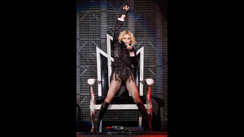 """Performing during the """"Sticky & Sweet"""" tour, Madonna sings onstage at the MGM Grand Garden Arena in Las Vegas on November 9, 2008."""