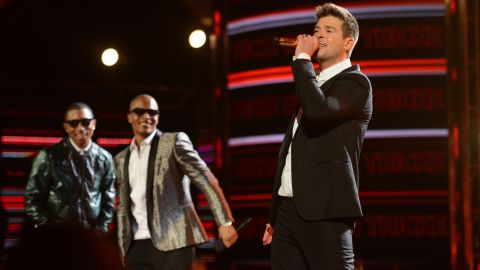 """Robin Thicke, right, had the song of the summer in 2013 with<a href=""""http://www.youtube.com/watch?v=yyDUC1LUXSU"""" target=""""_blank"""" target=""""_blank""""> """"Blurred Lines.""""</a> But the hit was dubbed """"rape-y"""" by some with its lyrics """"I know you want it"""" <a href=""""http://outfront.blogs.cnn.com/2013/06/18/does-robin-thickes-blurred-lines-promote-rape/"""">which critics said promoted sexual assault. </a>The music video also came under fire for its use of nude women and spurred <a href=""""http://www.youtube.com/watch?v=tKfwCjgiodg"""" target=""""_blank"""" target=""""_blank"""">a parody video</a> with scantly-clad men. Not to mention ... well, <a href=""""http://www.cnn.com/2013/08/26/showbiz/music/miley-cyrus-mtv-vmas-gaga/index.html"""">you know</a>."""