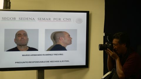 Pictures of Mario Armando Ramirez Trevino are presented during a press conference in Mexico City on August 18.
