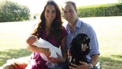 In August, Catherine and William pose with George and their dogs Lupo, right, and Tilly in the garden of Catherine's family home in Bucklebury, England.