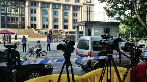 """Tight security is in place around the courthouse in Jinan, China, on Wednesday, August 21 -- the day before China's so-called """"trial of the century."""""""