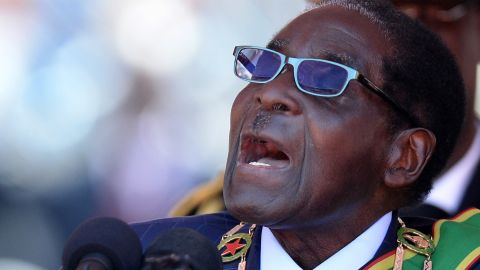 Zimbabwean Robert Mugabe addresses his inauguration ceremony in Harare on August 22, 2013 at the 60,000-seater sports stadium in Harare. Veteran leader Robert Mugabe was sworn in as Zimbabwe's president for another five-year term before a stadium packed with tens of thousands of jubilant supporters. AFP PHOTO / ALEXANDER JOE (Photo credit should read ALEXANDER JOE/AFP/Getty Images)