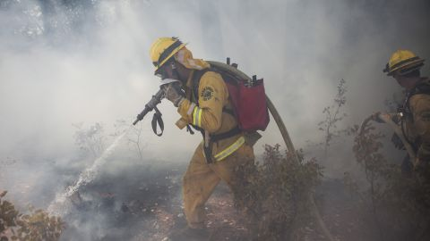 A Marin County firefighter works to put out a spot fire that jumped a fire line on the Rim Fire near Groveland, California, August 22.