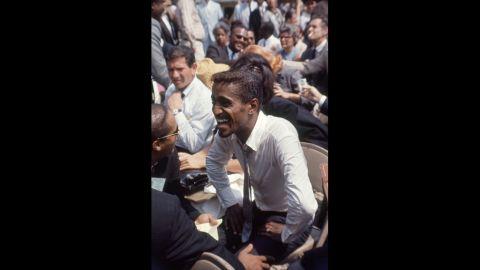 African-American entertainer Sammy Davis Jr. attends the rally.