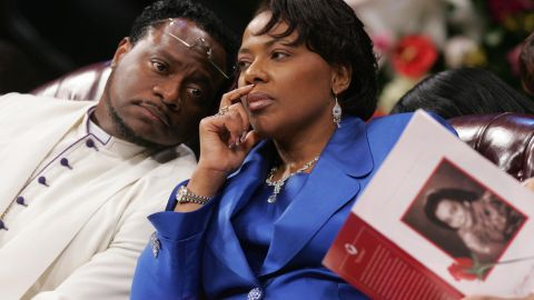 Bernice King confers with Bishop Eddie Long during a 2006 funeral service for her mother at Long's church.