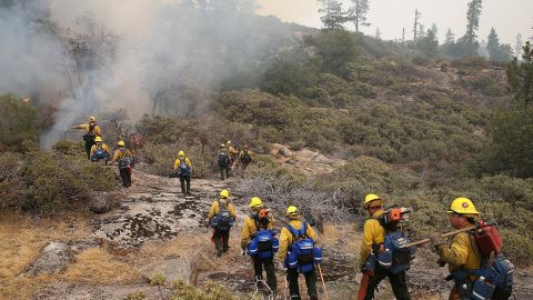 Firefighters move in to douse a spot fire on August 24.
