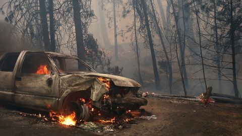 A burned car sits on the side of the road near Groveland on August 25.