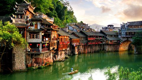"""Every year, armies of young backpackers flock to the ancient town of Fenghuang (which literally means """"Phoenix"""") in Hunan province, for its rich Miao and Tujia ethnic culture as well as a glorious photo opportunity."""