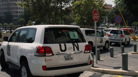 A convoy of United Nations (UN) vehicles leave a hotel in Damascus on August 26, 2013 carrying UN inspectors travelling to the site of a suspected deadly chemical weapon attack the previous week in Ghouta, east of the capital. The Syrian authorities approved the UN inspection of the site, but US officials said it was too little, too late, arguing that persistent shelling there in recent days had 'corrupted' the site.