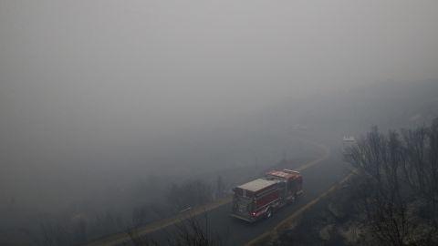 Firetrucks drive through heavy smoke generated by the Rim Fire near Yosemite on August 27.