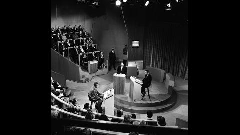 Moderator John McCaffery, left, segregationist editor James J. Kilpatrick and King debate segregation in New York on November 11, 1960.