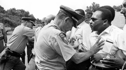 """Mississippi patrolmen shove King during the 220-mile """"March Against Fear"""" from Memphis, Tennessee, to Jackson, Mississippi, on June 8, 1966."""