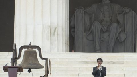 Trumpeter Geraldo Marshall opens Wednesday's ceremonies at the Lincoln Memorial.