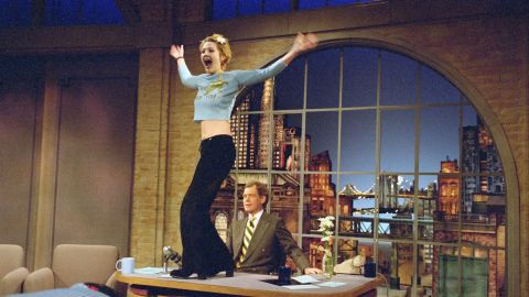 """When Drew Barrymore showed up on """"Letterman"""" in 1995, she came bearing gifts -- of a sort. The then-20-year-old actress was a ball of """"good energy,"""" and when talk turned to her interest in """"nude performance dance,"""" Letterman of course had to get a preview -- complete with flashing. It was his birthday, after all."""