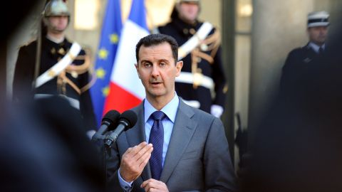 Al-Assad delivers a speech at Elysee Palace in Paris on December 9, 2010, after sharing a working lunch with his French counterpart, Nicolas Sarkozy, during a two-day official visit to France.