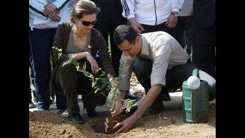 Asma al-Assad plants a jasmine bush with her husband in old Damascus on April 27, 2007.