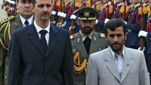 Al-Assad and Iran's Mahmoud Ahmadinejad review the honor guard at Damascus airport on January 19, 2006.
