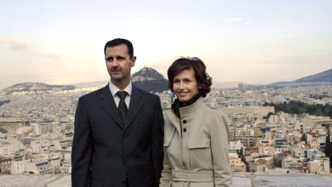 Al-Assad and his wife, Asma, pose during their visit to the Acropolis in downtown Athens on December 15, 2003.