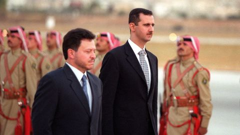 Jordanian King Abdullah ll and al-Assad inspect the honor guard on October 18, 2000, in Amman, Jordan.