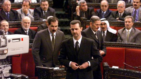 Al-Assad prepares to deliver a speech to parliament on July 17, 2000.  It would be his first speech to parliament after taking the oath of office to become Syria's new president.