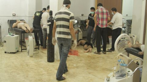 People attend to the victims of the attack on August 21 in Damascus. British intelligence said at least 350 people died, while rebel leaders have put the death toll at more than 1,300.