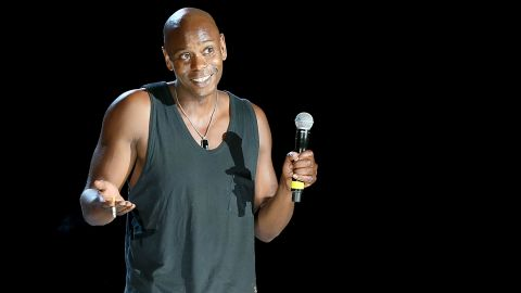 """Given how <a href=""""http://marquee.blogs.cnn.com/2013/08/30/dave-chappelle-walks-off-stage-during-hartford-show/"""">rowdy the crowd </a>was at Dave Chappelle's August 2013 show in Hartford, Connecticut, his abrupt exit speech was remarkably polite. """"I like some of you, I hate some of you. I forgive some of you, but I don't forgive all of you."""" And then, amid escalating boos, the comedian dropped the mic and cued Kanye West's """"New Slaves."""" Chappelle is seen here at an earlier performance."""