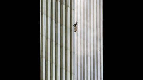 """Richard Drew captured this image of a man falling from the World Trade Center in New York after the terror attacks on September 11, 2001. Its publication led to a public outcry from people who found the photograph insensitive. Drew sees it differently. <a href=""""http://www.thedailybeast.com/articles/2011/09/08/richard-drew-s-the-falling-man-ap-photographer-on-his-iconic-9-11-photo.html"""" target=""""_blank"""" target=""""_blank"""">On the 10th anniversary of the attacks</a>, he said he considers the falling man an """"unknown soldier"""" who he hopes """"represents everyone who had that same fate that day."""" It's believed that upwards of 200 people fell or jumped to their deaths after the planes hit the towers."""