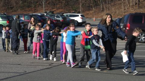 """In the immediate aftermath of the 2012 shooting at Sandy Hook Elementary School, local journalist Shannon Hicks witnessed police escorting children out of the school in Newtown, Connecticut. """"I knew that, coming out of the building -- as terrified as they were -- those children were safe,"""" <a href=""""http://lightbox.time.com/2012/12/20/the-story-behind-the-iconic-photograph-from-sandy-hook/#1"""" target=""""_blank"""" target=""""_blank"""">Hicks later told Time magazine</a>. """"I just felt that it was an important moment."""" The photograph made it onto the front pages of newspapers, magazines and websites around the world."""