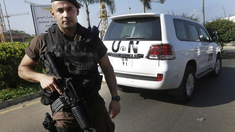 """A Lebanese special forces policeman escorts the vehicles of U.N. experts on the arrival at the private jet terminal, at Beirut international airport, Lebanon, Saturday, Aug. 31, 2013. The U.N. experts investigating last week's alleged chemical weapons strike outside Damascus left Syria early Saturday and crossed into neighboring Lebanon, departing hours after President Barack Obama said he is weighing """"limited and narrow"""" action against a Syrian regime that the administration has bluntly accused of launching the deadly attack. (AP Photo/Hussein Malla)"""