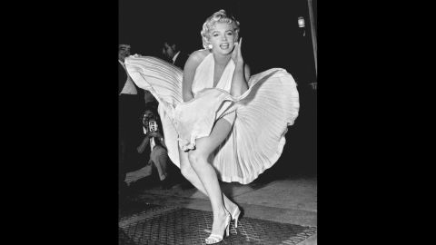 """Five decades after her death, Marilyn Monroe remains one of Hollywood's most adored sex symbols. Her sultry legacy is often traced back to the 1954 image of her posing over a New York City subway grate in character for the filming of """"The Seven Year Itch."""" Monroe's then-husband, Joe DiMaggio, reportedly witnessed the spectacle and became enraged with jealousy. They divorced weeks later."""
