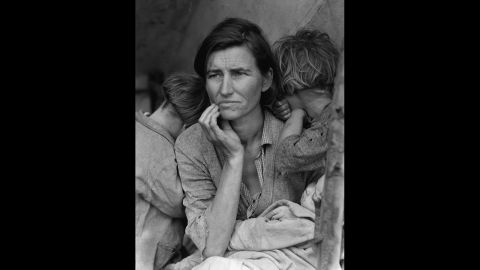 """Dorothea Lange's photograph of a struggling mother with her children in 1936 became an icon of the Great Depression. Lange was traveling through California, taking photographs of migrant farm workers for the Resettlement Administration, when she came across Florence Owens Thompson. """"I saw and approached the hungry and desperate mother, as if drawn by a magnet,"""" <a href=""""http://www.loc.gov/rr/print/list/128_migm.html"""" target=""""_blank"""" target=""""_blank"""">Lange recalled</a> in 1960. The image was retouched to remove the woman's thumb from the lower right corner."""