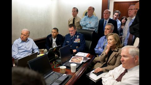 """President Barack Obama and members of his national security team monitor the Navy SEALs raid that killed Osama bin Laden in 2011. It was a crucial moment in American history, and White House photographer Pete Souza captured the tension in the room. """"It was probably one of the most anxiety-filled periods of time, I think, in the lives of the people who were assembled,"""" counterterrorism adviser <a href=""""http://www.cnn.com/2011/POLITICS/05/03/iconic.obama.photo/index.html"""">John Brennan later told reporters</a>. A classified document on the table was obscured by the White House."""