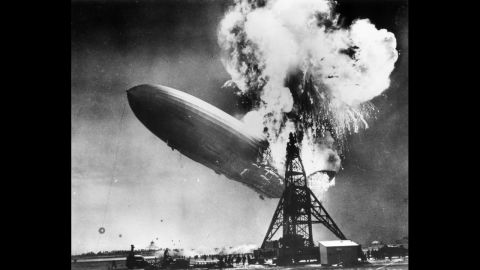 """In 1937, Sam Shere photographed the Hindenburg disaster while on assignment in New Jersey. The crash killed 36 people and ended the era of passenger-carrying airships, which were once hailed as the future of flight. """"I had two shots in my (camera) but I didn't even have time to get it up to my eye,"""" <a href=""""http://www.telegraph.co.uk/expat/expatpicturegalleries/8502342/History-as-it-happened-the-photographs-that-defined-our-times.html"""" target=""""_blank"""" target=""""_blank"""">Shere later said</a>. """"I literally shot from the hip -- it was over so fast there was nothing else to do."""""""
