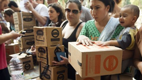 Israelis queue up to collect gas mask kits at a distribution center in the Mediterranean coastal city of Haifa, northern Israel, on August 29, 2013.