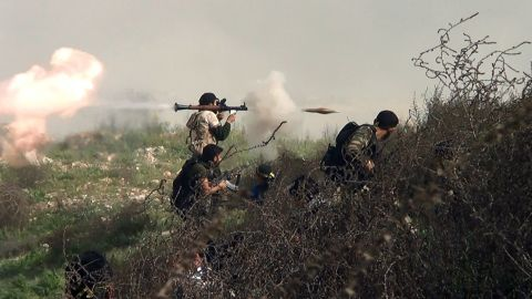 An image grab taken from a video shows an opposition fighter firing an rocket propelled grenade (RPG) on August 26, 2013 during clashes with regime forces over the strategic area of Khanasser, situated on the only road linking Aleppo to central Syria.