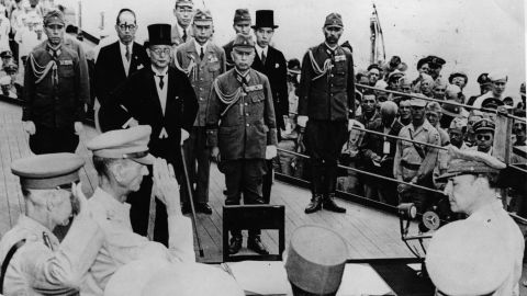 2nd September 1945:  Sir Arthur Percival and Jonathan Wainwright salute General Douglas MacArthur (1880 - 1964) as Supreme Commander of the Allied Forces just before he accepts the Japanese unconditional surrender document. Mamoru Shigemitsu, the top-hatted foreign minister, along with General Yoshijiro Umezu, the army chief of staff, lead the Japanese delegaation, on board the USS Missouri in Tokyo Bay.  (Photo by Keystone/Getty Images)