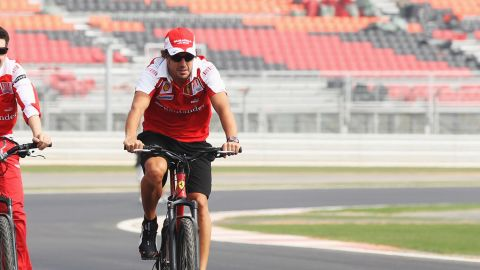 Ferrari's Fernando Alonso is preparing to become a team boss after announcing plans to buy the Euskaltel Euskadi cycling team.