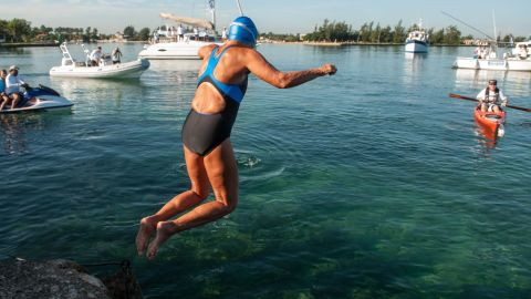 Nyad jumps into the water to begin her fifth attempt at crossing the Straits of Florida on Saturday, August 31.