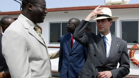 The youngest son of Britain's Queen Elizabeth II, Prince Edward, right, is greeted by Goree Island Mayor Augustin Senghore upon his arrival at Goree Island, Senegal, on June 6, 2004.