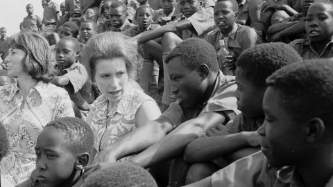 Princess Anne sits with a group of Kenyan orphans as they watch a soccer match at Starehe Boys' Centre in Nairobi, Kenya on February 8, 1971.