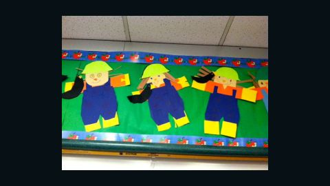 """C.J. made a long-haired version of himself -- the paper farmer in the middle -- during """"Going To The Farm"""" week in kindergarten."""