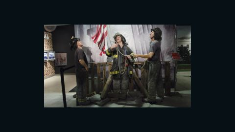 """Wax figures of New York City firefighters raising the American flag at Ground Zero are displayed during the """"HOPE: Humanity And Heroism"""" 9/11 wax exhibition at Madame Tussauds in Washington, DC., on May 10."""