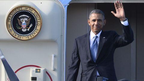 U.S. President Barack Obama waves as he arrives at the Arlanda Airport in Stockholm, Sweden, on September 4, 2013.
