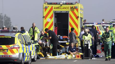 Injured people are treated on the road.