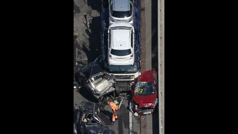 An aerial shot of the bridge shows crushed cars.