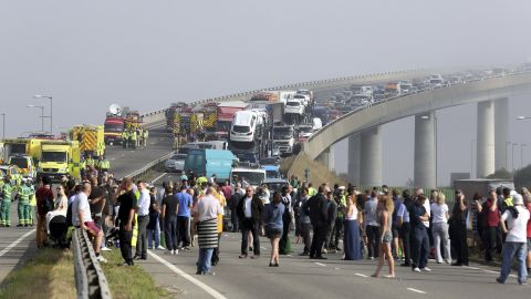 People gather at the scene of the crash.
